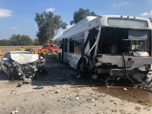 A bus and a sedan sit on the 405 Freeway in the North Hills area following a crash on Oct. 14, 2018. (Credit: Los Angeles Fire Department)