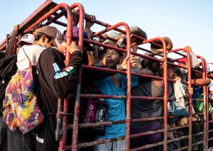 Honduran migrants heading in a caravan to the US, travel on a truck near Pijijiapan, southern Mexico on October 26, 2018. - The Pentagon is expected to deploy about 800 troops to the US-Mexico border, two US officials told AFP on Thursday, after President Donald Trump said the military would help tackle a 'national emergency' and called on a caravan of US-bound migrants to turn around. (Credit: Guillermo Arias/AFP/Getty Images)
