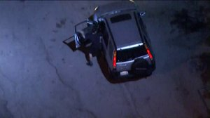 The suspect in a chase in North Hollywood on Oct. 1, 2018, appears to carjack someone just moments before the pursuit came to an end. (Credit: KTLA)