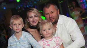Yana Lavrenteva is surrounded by her husband and their two children in this undated photo provided by the family.