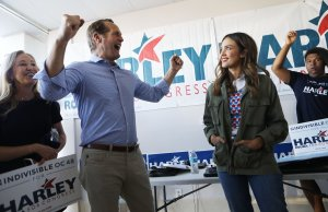 Actress Jessica Alba joins Democratic congressional candidate Harley Rouda as he greets supporters at a campaign canvass launch on Oct. 20, 2018, in Costa Mesa. (Credit: Mario Tama / Getty Images)