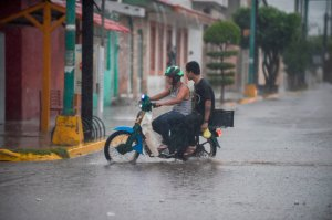 Resident rides their motorcycle as the Hurricane Willa arrives to Escuinapa, Sinaloa state, Mexico, on Oct. 23, 2018. (Credit: Alfredo Estrella / AFP / Getty Images)