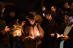 People hold candles outside the Tree of Life Synagogue after a shooting there left 11 people dead in the Squirrel Hill neighborhood of Pittsburgh on Oct. 27, 2018. (Credit: BRENDAN SMIALOWSKI/AFP/Getty Images)