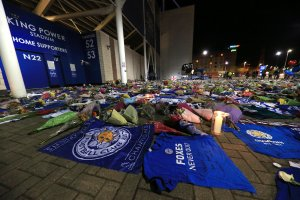 Tributes are seen as mourners pause to pay tributes after the helicopter crash at The King Power Stadium on Oct. 28, 2018 in Leicester, England.(Credit: Stephen Pond/Getty Images)