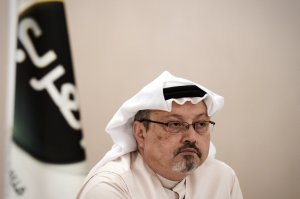 A general manager of Alarab TV, Jamal Khashoggi, looks on during a press conference in the Bahraini capital Manama, on December 15, 2014. (Credit: MOHAMMED AL-SHAIKH/AFP/Getty Images)