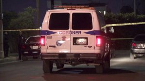 Coroner's officials respond to the scene of a fatal shooting in the Harvard Heights neighborhood of Los Angeles on Oct. 16, 2018. (Credit: KTLA)