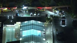 Paramedics and first responders go through the scene of an incident of pool chemical exposure in Thousand Oaks on Oct. 3, 2018, that left 20 people hospitalized, with seven suffering critical injuries. (Credit: KTLA)