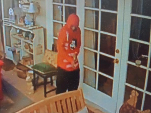 A burglary suspect is seen in an Encino home in a still from surveillance video released by Los Angeles police on Oct. 19, 2018.