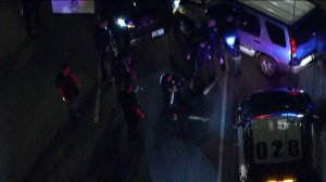 The suspect in a police pursuit in North Hollywood on Oct. 1, 2018, is seen surrendering to LAPD. (Credit: KTLA)