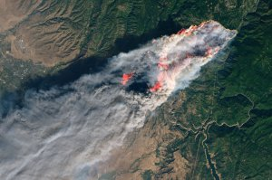 An image released by NASA on Nov. 9, 2018, shows the devastating and deadly Camp Fire in Northern California, as seen from space.