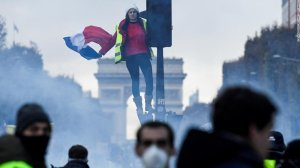 Police in Paris have fired tear gas and used water cannon against protesters on the Champs Elysées, in the center of the French capital. (Credit: CNN)