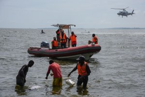 Rescuers search for victims at the site of a capsized cruise boat on Lake Victoria near Mutima village, south of Kampala, Uganda, on November 25, 2018. - Thirty people drowned and more than 60 were feared dead after a pleasure boat sank in Lake Victoria, Ugandan police said, in the latest such incident on Africa's largest body of water. (Credit: Isaac Kasamani/AFP/Getty Images)