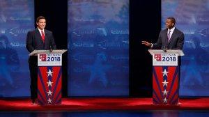 Republican Ron DeSantis (left) and Democrat Andrew Gillum (right) debate at Broward College on Oct. 24, 2018, in Davie, Florida. (Credit: Wilfredo Lee-Pool/Getty Images)