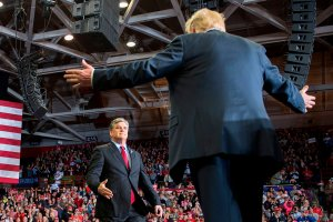 Donald Trump greets talk show host Sean Hannity at a Make America Great Again rally in Cape Girardeau, Missouri on Nov. 5, 2018. (Credit: by Jim Watson/AFP/Getty Images)