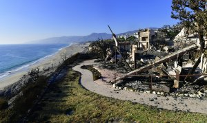 This photo shows the remains of a beachside luxury home along the Pacific Coast Highway community of Point Dume in Malibu on Nov. 11, 2018, as the battle to control the Woolsey Fire continues. (Credit: FREDERIC J. BROWN/AFP/Getty Images)