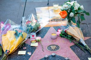 Fans leave tributes on Stan Lee's star on the Hollywood Walk of Fame shortly after the news that the Marvel founder died aged 95 was made public on Nov. 12, 2018. (Credit: Valerie Macon / AFP / Getty Images)
