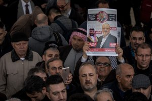 A man holds a poster showing a picture of Jamal Khashoggi after taking part in an absence prayer held after Friday pray at Fatih Mosque on Nov. 16, 2018. (Credit: Chris McGrath / Getty Images)