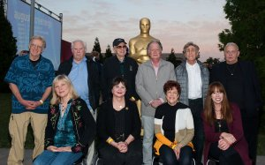 Art Rochester, Candy Clark, Fred Roos, Haskell Wexler, Cindy Williams, Willard Huyck, Gloria Katz, Ed Greenberg, Mackenzie Phillips and Bo Hopkins attends The Academy Of Motion Picture Arts And Sciences' Oscars Outdoors Screening Of 'American Graffiti' on August 2, 2013 in Hollywood. (Credit: Valerie Macon/Getty Images)