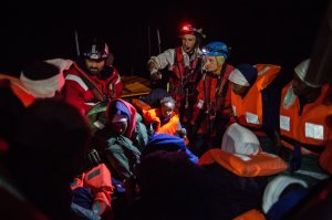 A group of migrants are transferred on Dec. 26 2017, from the Spanish war ship Santa Maria to the non-governmental organization Aquarius ship by SOS Mediterranee and Doctors Without Borders. Some 255 migrants were rescued overnight in the Mediterranean off the coast of Libya, just before a front of bad weather hit the area. (Credit: Federico Scoppa/AFP/Getty Images)