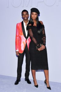 Christian Combs, left, and his mother Kim Porter attend the Tom Ford Women's Fall/Winter 2018 fashion show at Park Avenue Armory during New York Fashion Week on Feb. 8, 2018. (Credit: Dia Dipasupil / Getty Images)