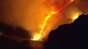 The Woolsey Fire is seen burning through a canyon area in L.A. County on Nov. 11, 2018. The fire had killed two people in Malibu by that time. (Credit: KTLA)