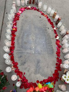 An unusual stain that bears a resemblance to the Virgin Mary is seen on a sidewalk in Artesia on Dec. 14, 2018, in a photo provided by the Holy Family Catholic Church.