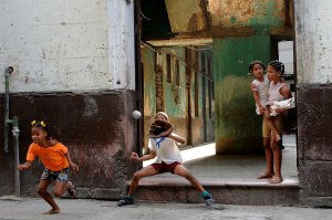 Cuban children play baseball in a street of Havana on Sept. 17, 2018. (Credit: YAMIL LAGE/AFP/Getty Images)