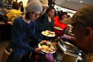Camp Fire evacuees wait in line to receive a free Thanksgiving meal at Sierra Nevada Brewery on Nov. 22, 2018, in Chico. (Credit: Justin Sullivan/Getty Images)