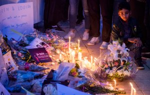A Moroccan boy looks at candles and flowers during a vigil for the two Scandinavian hikers who were killed in Morocco, outside the Danish Embassy in Rabat on Dec. 22, 2018. (Credit: Fadel Senna/AFP/Getty Images)