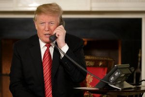 U.S. President Donald Trump takes phone calls from children as he participates in tracking Santa Claus' movements with the North American Aerospace Defense Command (NORAD) Santa Tracker on Christmas Eve in the East Room of the White House Dec. 24, 2018, in Washington, D.C. (Credit: Chip Somodevilla/Getty Images)