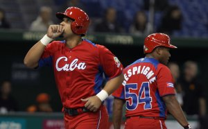 Jose Abreu # 79 of Cuba celebrates after hits a solo home run in the fourth inning during the World Baseball Classic Second Round Pool 1 game between Cuba and the Netherlands at Tokyo Dome on March 11, 2013 in Tokyo, Japan. (Credit: Chung Sung-Jun/Getty Images)