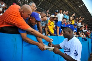Cuban MLB player Yasiel Puig signs autographs at the Latin American Stadium in Havana on Dec. 16, 2015. (Credit: YAMIL LAGE/AFP/Getty Images)