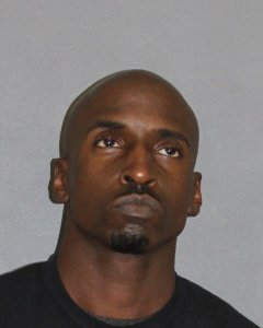 Emanuel Demar Banks, 38, is seen in a booking photo released Dec. 11, 2018, by Irvine police.