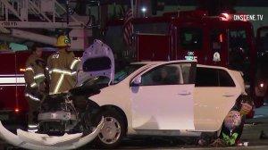 Investigators look through the scene of a deadly crash in Santa Ana on Dec. 2, 2018. (Credit: Onscene)