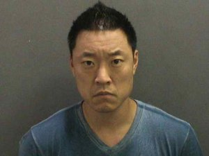 Edward Younghoon Shin, 41, is seen in a booking photo released by the Orange County District Attorney's Office on Dec. 7, 2018.