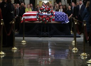 Mourners pay their respects in front of the casket of the late former President George H.W. Bush as he lies in state in the U.S. Capitol Rotunda, Dec. 4, 2018, in Washington, D.C. (Credit: Mark Wilson/Getty Images)