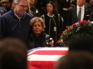 Jeb Bush and his wife Columba Bush pay their respects in front of the casket of the late former President George H.W. Bush as he lies in state in the U.S. Capitol Rotunda, Dec. 4, 2018, in Washington, D.C.(Credit: Mark Wilson/Getty Images)