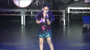 Kaylin Guevara sings on stage at the Orange County School of the Arts as she lived her dream of being a pop star for a day with help from the Make-A-Wish Foundation. (Credit: KTLA)