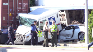 Authorities investigate the scene of a fatal collision involving a postal worker in Monterey Park on Dec. 3, 2018. (Credit: OC Hawk)