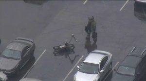 A bomb squad technician is seen working at Citrus College in Glendora during a campus lockdown on Jan. 15, 2019. (Credit: Sky5)