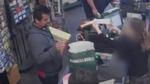 A man suspected of a vehicle burglary in West L.A. is seen making purchases in this still from surveillance video released by LAPD on Jan. 22, 2019.