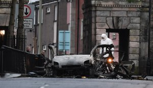 A forensic officer inspects the remains of the van used as a car bomb on an attack outside Derry Court House on January 20, 2019 in Londonderry, Northern Ireland. (Credit: Charles McQuillan/Getty Images)