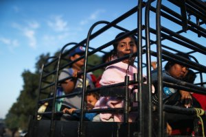 People from a caravan of Central American migrants wait to depart on a truck, whose driver offered a ride, on their way toward the United States, on Jan. 22, 2019 in Santo Domingo Zanatepec, Mexico. (Credit: Mario Tama / Getty Images)