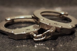 A pair of handcuffs is shown in a file image. (Credit: Moment via Getty Images)