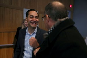 Former U.S. Secretary of Housing and Urban Development Julian Castro talks with an attendee during the Clark County Democrats' Steering Committee Meeting at Sierra Vista High School on Jan. 08, 2019, in Las Vegas, Nevada. (Credit: Justin Sullivan/Getty Images)