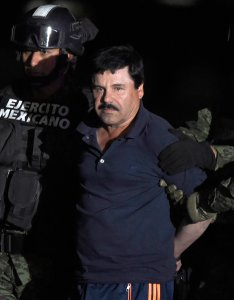 """Drug kingpin Joaquin """"El Chapo"""" Guzman is escorted into a helicopter at Mexico City's airport on Jan. 8, 2016, following his recapture during an intense military operation in Los Mochis, in Sinaloa State. (Credit: ALFREDO ESTRELLA/AFP/Getty Images)"""