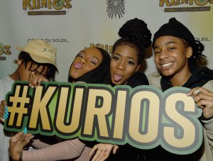 "The Kelly family (from left) – Robert Jr., Andrea, Joann and Jaah – attend the Atlanta premiere Of Cirque du Soleil's ""Kurios"" on March 3, 2016. (Credit: Rick Diamond / Getty Images for Cirque du Soleil)"