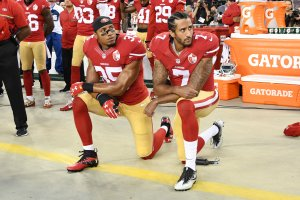Colin Kaepernick, right, and Eric Reid of the San Francisco 49ers kneel in protest during the national anthem prior to playing the Los Angeles Rams at Levi's Stadium in Santa Clara on Sept. 12, 2016. (Credit: Thearon W. Henderson / Getty Images)