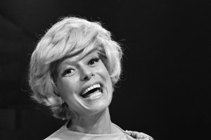 """American singer and actress Carol Channing smiles during the shooting of her Emmy-winning television special, """"An Evening With Carol Channing,"""" on Aug. 29, 1965. (Credit: CBS Photo Archive / Getty Images)"""