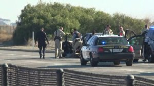 CHP officers pull a driver from a vehicle on the side of the 5 Freeway in the Camp Pendleton area after a lengthy pursuit and standoff on Jan. 3, 2019. (Credit: KTLA)